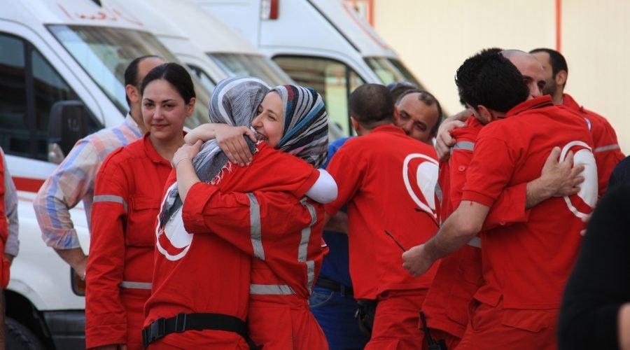 Red Cross Volunteers Assisted by Mental Health Volunteers